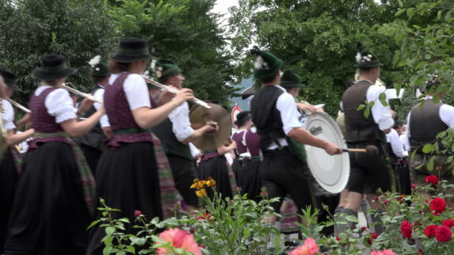 Parade with traditional costume and brass band in Bavaria