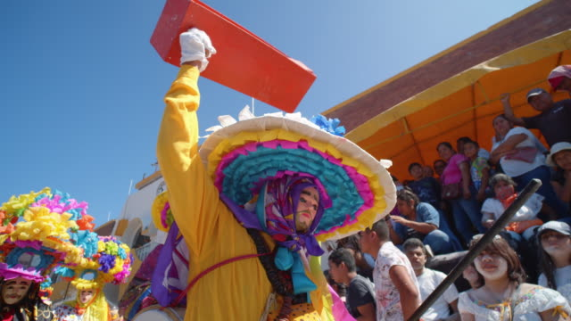 paraders wearing colorful creative costumes at the the zoque coiteco festival parade in chiapas, mexico - chiapas stock-videos und b-roll-filmmaterial