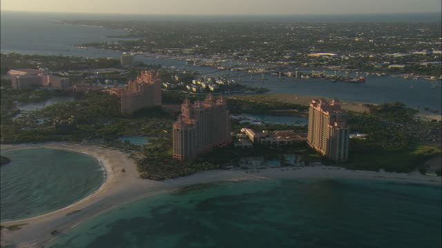 AERIAL Paradise Island and Atlantis resort with city of Nassau in background, Bahamas