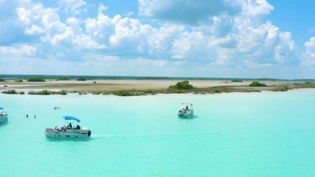 paradise white sand beach island in the caribbean bacalar lagoon, mexico - lagoon stock videos & royalty-free footage