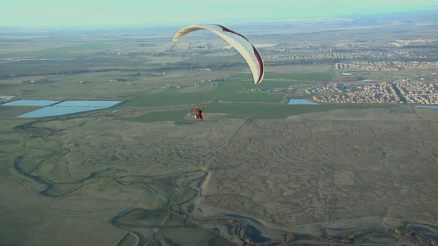 aerial ws pan paraglider flying above countryside / lincoln, california, usa - ski flying stock videos and b-roll footage