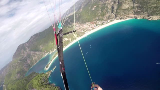 pov paraglider flying over the mediterranean sea - paragliding stock videos & royalty-free footage