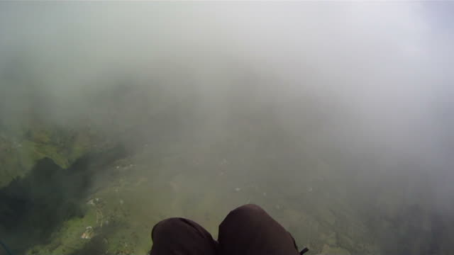 paraglider flying through cloud - paragliding stock videos & royalty-free footage