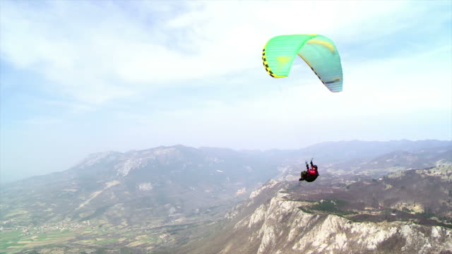 hd: paraglider having fun in the air - gliding stock videos and b-roll footage