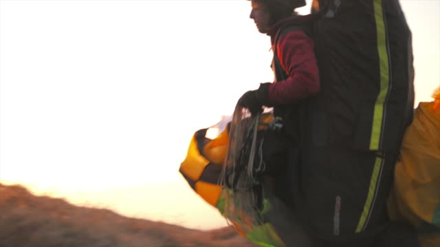 hd: paraglider heading to launch point - paragliding stock videos & royalty-free footage