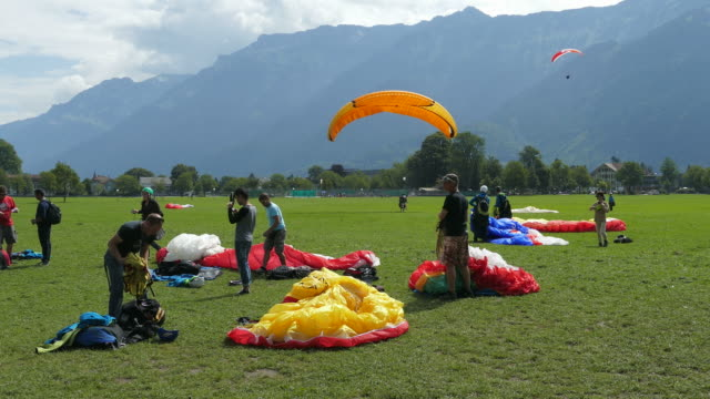 paraglider in interlaken, bernese oberland, canton of bern, switzerland - parachute stock videos & royalty-free footage