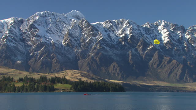 paraglider in queenstown, new zealand - paragliding stock videos & royalty-free footage