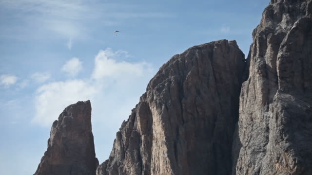 paraglider in the sky on dolomites - hang gliding stock videos and b-roll footage