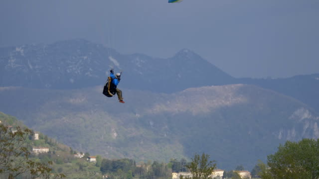 paraglider landing behind trees - lightweight stock videos & royalty-free footage