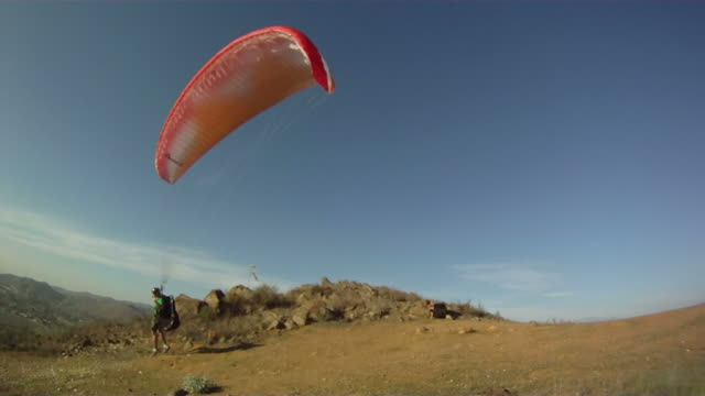 paraglider launches parachute and glides into the distance - anticipation stock videos & royalty-free footage