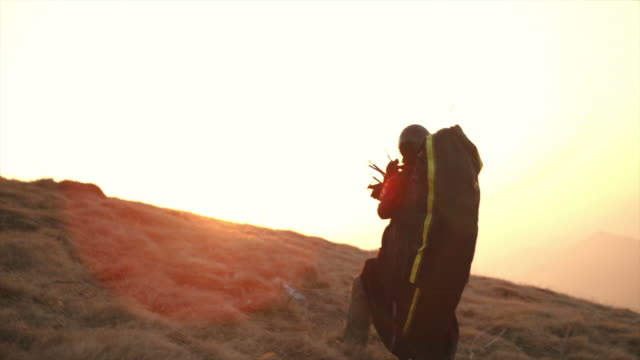 hd: paraglider launching off the hill - paragliding stock videos & royalty-free footage