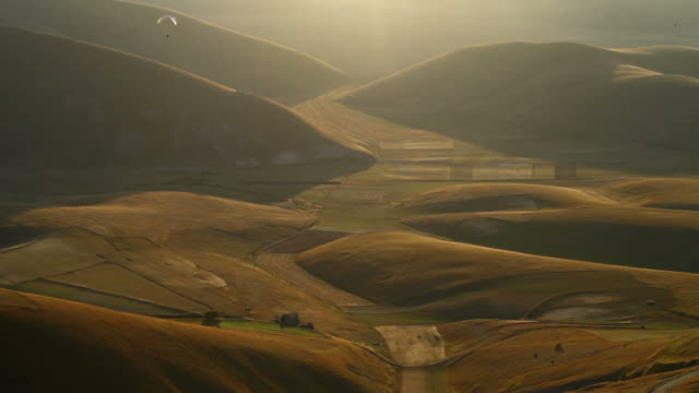 Paraglider over a valley