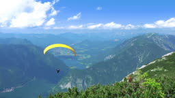 Paraglider over Mountains and Lkes. UHD