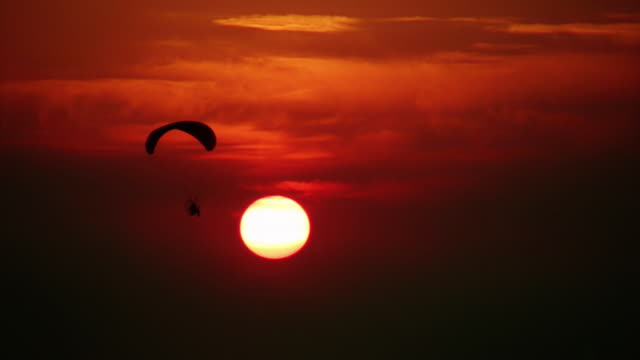 paraglider, sunset. - parachuting stock videos and b-roll footage