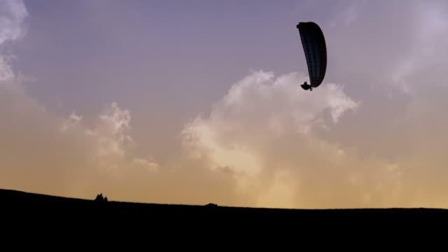 paragliders evolutions in the sky - hang gliding stock videos and b-roll footage