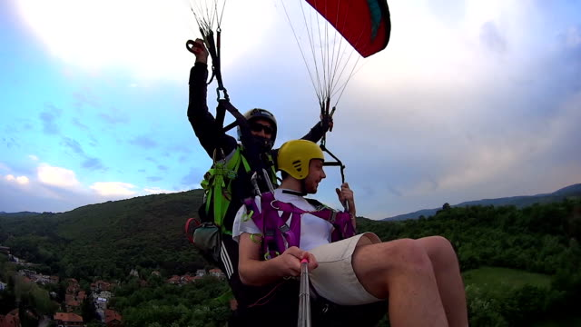paragliders flying over the mountain - real time stock videos & royalty-free footage