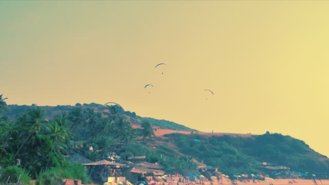 T/L paragliders over beach, Anjuna, Goa