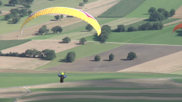 paragliding in jura mountains - hang gliding stock videos and b-roll footage