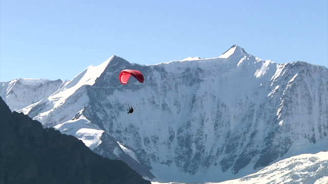 paragliding near grindelwald - paragliding stock videos & royalty-free footage