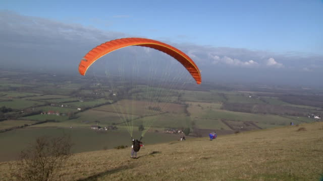 paragliding on the south downs, uk - hill stock videos & royalty-free footage