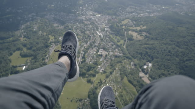 pov paragliding over forest and towns - paragliding stock videos & royalty-free footage