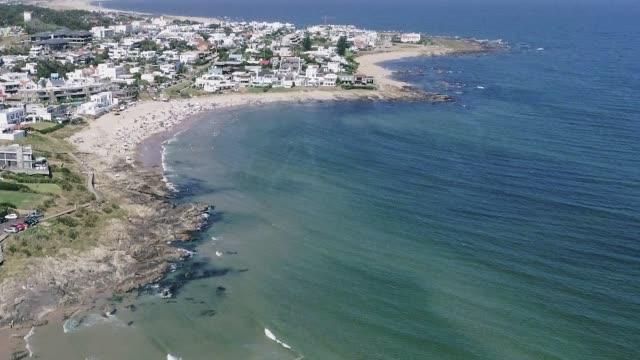 paragliding over la barra beach, punta del este city, uruguay - sedative stock videos & royalty-free footage