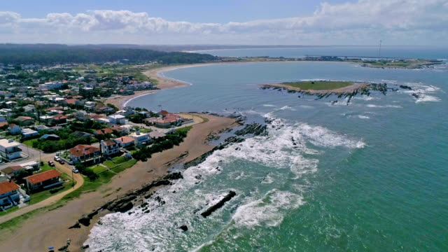 stockvideo's en b-roll-footage met paragliding over la paloma coastline in rocha department, uruguay - uruguay