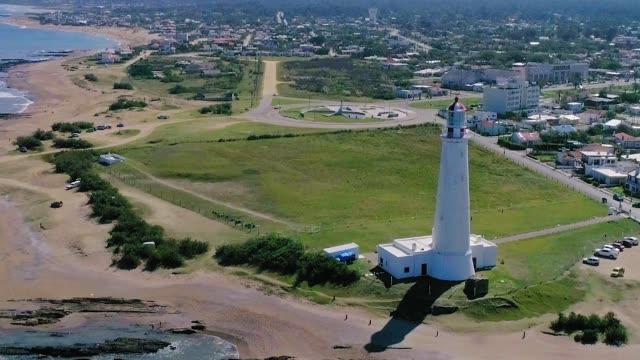 paragliding over la paloma lighthouse in rocha department, uruguay - 鎮静薬点の映像素材/bロール