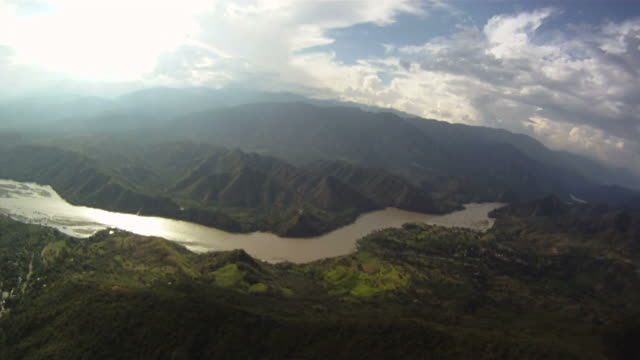 para-gliding over river in picturesque valley. - exhilaration stock videos and b-roll footage