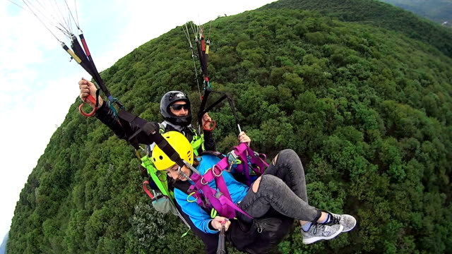 paragliding over the mountain - real time stock videos & royalty-free footage