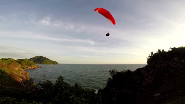 paragliding over the mountains against clear blue sky - paragliding stock videos & royalty-free footage