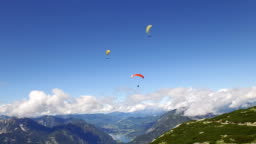 paragliding over the rocky Alps mountains landscape
