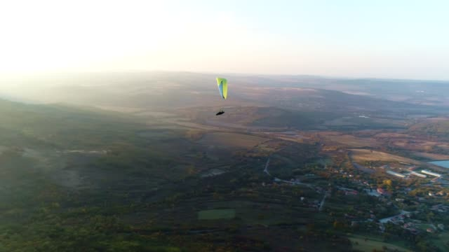ws pan pov paragliding pilot in the mid-air, flying, cross country pilot, extreme sports, adventure - extreme sports point of view stock videos & royalty-free footage