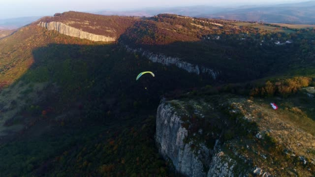 WS PAN POV Paragliding pilot in the mid-air, flying, cross country pilot, extreme sports, adventure
