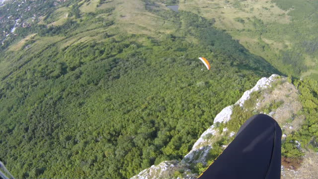 pov of paragliding pilot in the mid-air, flying in the sky. cross country pilot in extreme sports and adventures. - skydiving stock videos & royalty-free footage