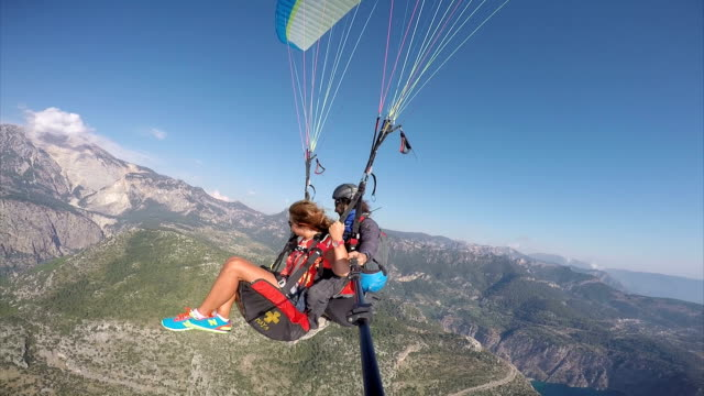 paragliding. (zero retouche) - oludeniz stock videos and b-roll footage