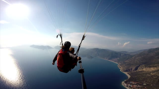 paragliding. (zero retouche) - mugla province stock videos & royalty-free footage