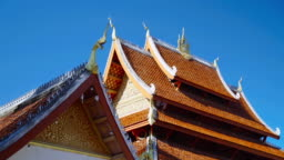 Parallax of Traditional Architecture of Buddhist Temple Roof Top on Clear Blue Skys