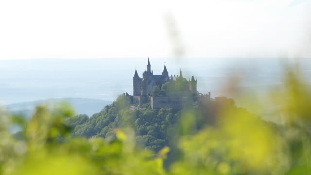 parallax shot of hohenzollern castle in the distance - castle stock videos & royalty-free footage