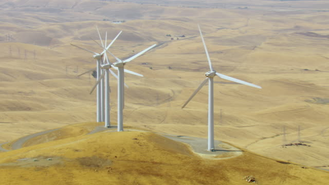parallax shot of wind turbines in california - energia rinnovabile video stock e b–roll