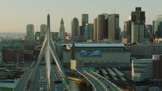 parallax shot of zakim bridge in boston - boston massachusetts stock-videos und b-roll-filmmaterial