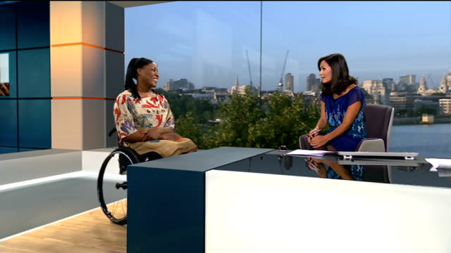 paralympian anne wafula strike completes 'tough mudder' challenge england london gir int anne wafula strike live studio interview sot - tough mudder stock videos and b-roll footage