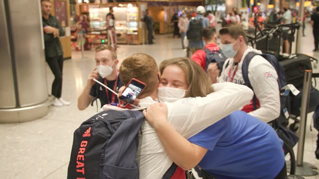 paralympians hug their friends and family on arrival back into the uk at heathrow on september 06, 2021 in london, england. team gb ranked second in... - persons with disabilities stock videos & royalty-free footage