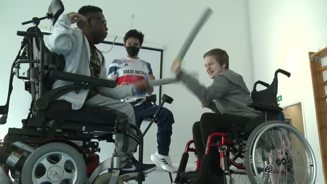 paralympians inspiring children at home; england: london: camberwell: int gv oliver lam-watson teaching wheelchair fencing to children in wheelchairs... - activity stock videos & royalty-free footage