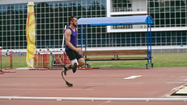 paralympic athlete practicing triple jump - artificial limb stock videos & royalty-free footage