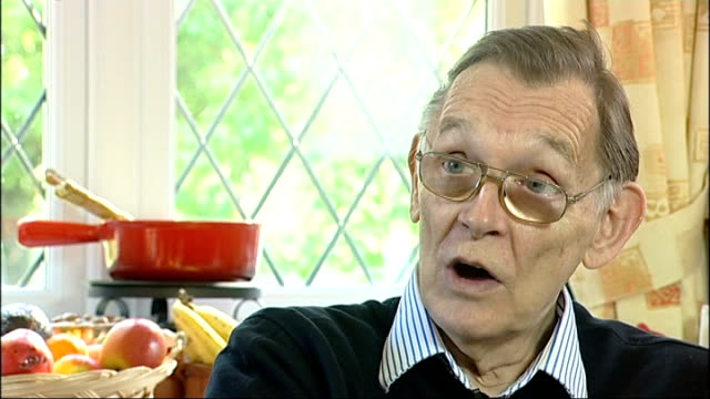 paralympic games founder sir ludwig guttmann to have statue at stoke mandeville hospital int shots of philip putting invitations in envelopes for the... - parallelo video stock e b–roll