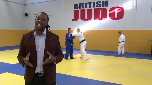 judo: paralympics gb announces its squad; jonathan drane and chris skelley competing in judo match reporter to camera jonathan drane and chris... - 柔道点の映像素材/bロール