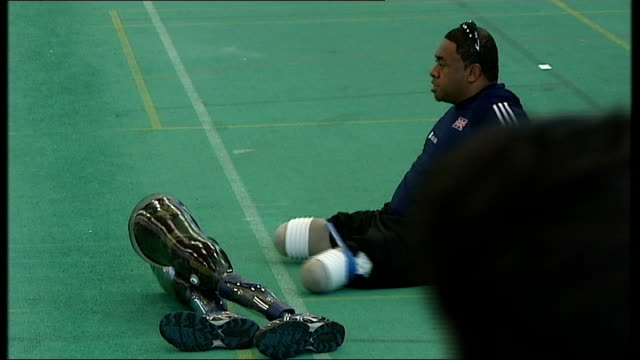 day one; england: manchester: int general views of paralympic athletes warming up various of richard whitehead lying on massage table derek... - massage table stock videos & royalty-free footage