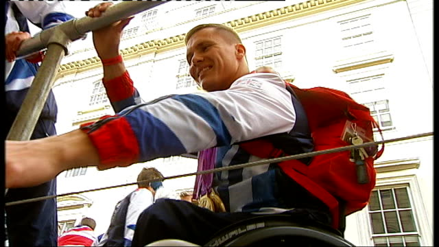 paralympics gold medallist david weir awarded freedom of the city of london cutaways ext david weir with his gold medals on float during olympic and... - parade float stock videos and b-roll footage