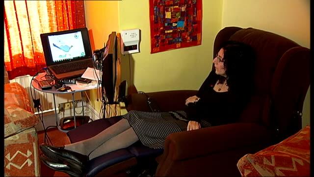 vídeos de stock e filmes b-roll de paralysed artist uses technology to create new works england london hendon int various of artist sarah ezekiel paralysed from the neck down by motor... - ícone de seta